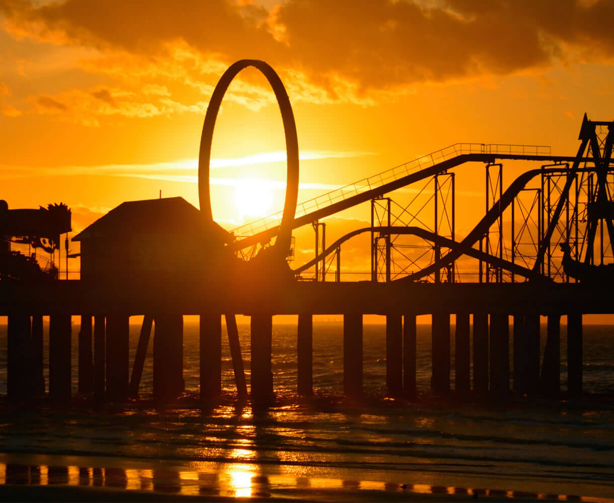 Picture of pleasure pier at sunset.