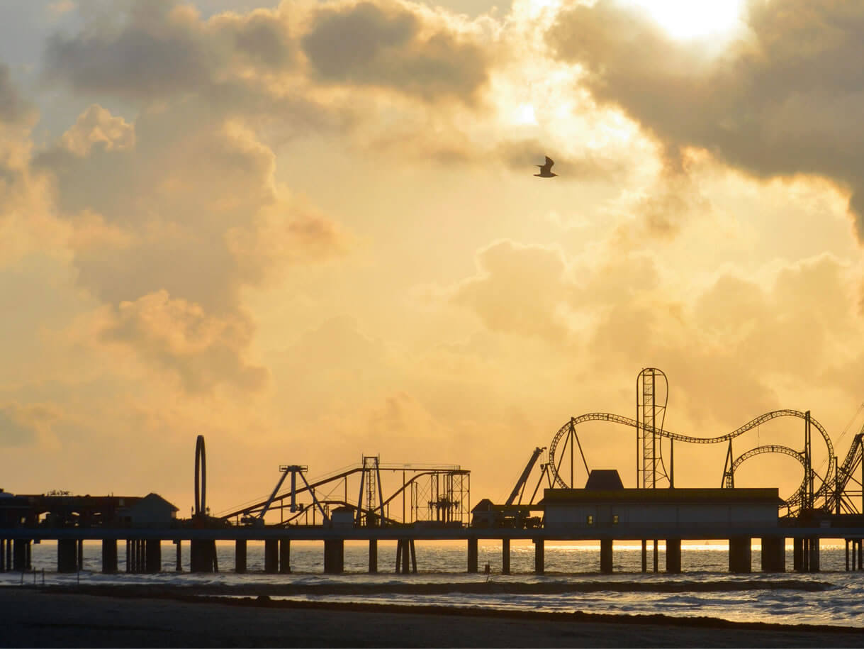coaster and pier at sunset